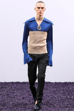 [JW Anderson]: long sleeves, corset moment, open-flare cut trousers