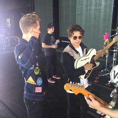 brad with his guitar and then theres james