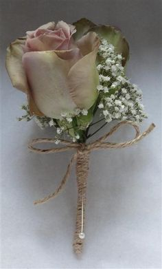 Amnesia Rose and Gypsophila button hole