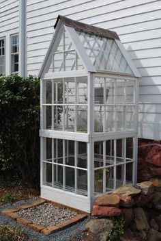Check out this seed-starter greenhouse fashioned from castoff windows and recycled metal roof tiles. | thisoldhouse.com