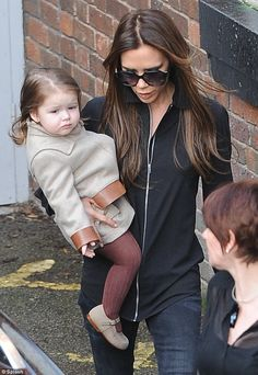 Shes a little star: Victoria Beckham was seen carrying her daughter Harper as they went to watch her niece in a local production
