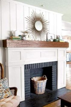 fireplace redo after with white wood trim, rustic mantelshelf and black-painted firebox by ursula
