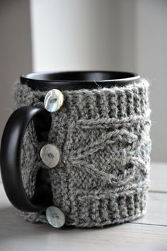 Mug sweater helps to keep your hot drink warm longer and you can hold the cup without burning your hands. Knitted cup cozy has three shiny