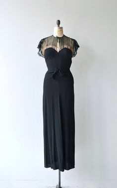 Vintage 1930s jet black rayon crepe gown with sheer net over pink trimmed sweetheart bodice, black sequined shoulders add a bit of drama, tie neckline, tie at waist, back kick pleat and metal side zipper. --- M E A S U R E M E N T S --- fits like: small bust: 33-34 waist: 26 hip: 35 length: 55 brand/maker: n/a condition: excellent to ensure a good fit, please read the sizing guide: http://www.etsy.com/shop/DearGolden/policy ✩ layaway is available for this...