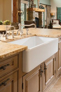 Farmhouse sinks turn back the clock! We love it with our versailles pattern floor in this Pittsburgh area home.