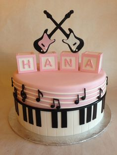 Fondant musical baby shower cake| Baby blocks| Electric guitars| Piano border.