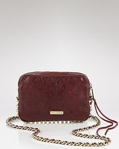 this handbag is a must on game days! It holds all necessary items while also keeping your hands free for the Aggie yells! It completes the overall outfit by being in the gold/brown families of the accessories and boots!