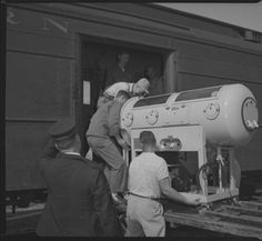 1952 donated iron lung be loaded on a train Rugby, North Dakota to help in the polio fight http://digitalhorizonsonline.org/cdm/singleitem/collection/ndsu-strand/id/19/rec/89