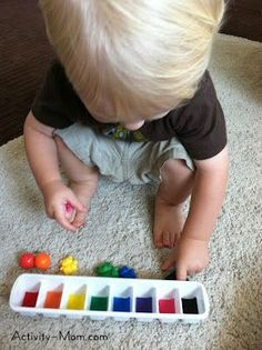 Learning with Your 17 Month Old - colour matching, hot glue some felt rectangles onto the bottom of each cube and add some objects of the same colour for him to match