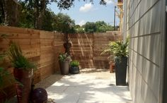 Custom brick planter, potted plants, and limestone pavers, makes an awesome oasis for this downtown condo.