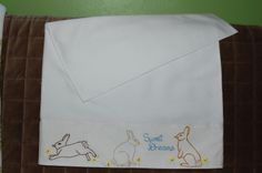 pillowcase I embroidered for grandson, has different bunnies on other side and is lined with woodland print to cover the hand embroidery on the inside