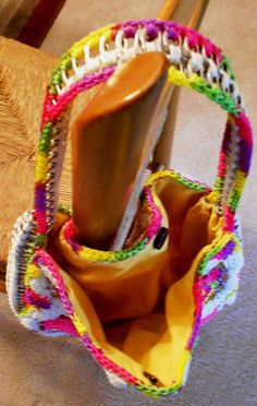Tabs from pop cans used to make this crocheted purse/bag.