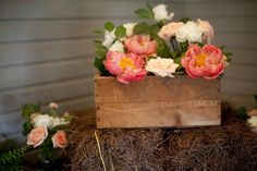 Gorgeous peach and pink garden flowers in a rustic wooden box. #Southern #weddings Lenora's Legacy Estate Photo Gallery