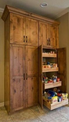 LOVE this cabinet color and rustic look. & that is an awesme pantry. Pull out dr… LOVE this cabinet color and rustic look. & that is an awesme pantry. Pull out drawers are awesome - Kitchen Pantry Cabinets Designs Kitchen Pantry Cabinets, Diy Kitchen, Kitchen Decor, Kitchen Ideas, Pantry Ideas, Awesome Kitchen, Kitchen Cabinets Floor To Ceiling, Wood Pantry Cabinet, Kitchen Designs