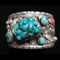 This Turquoise and Coral Tribal Cuff Bracelet was hand crafted in the foothills of the Himalayas by our friend Guitarra, an amazing female jewelry designer...Her tribal jewelry designs are awe inspiri