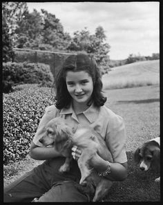 Walker Evans (American, 1903–1975). [Wendy Burden Seated on Lawn with Puppy, Bedford, New York], June 21, 1940. The Metropolitan Museum of Art, New York. Walker Evans Archive, 1994 (1994.254.74)