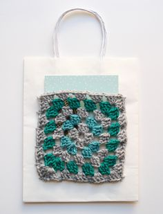 Add a granny square pocket to a gift bag and slip a greeting card inside!