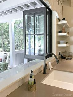 folding window to open to outdoor bar area from kitchen