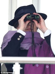 Princess Anne appeared tense as she watched the action through a pair of binoculars...