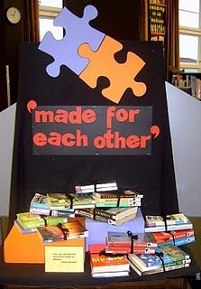 DISPLAY: Made for Each Other (Elaine Pearson) This display is to promote books that are linked in some way, not the obvious formula fiction series which sell themselves, but books linked in more subtle ways.  This display cost me nothing as I recycled card from old displays. To give some height to the books I covered some boxes to match  the display. I tied the related books together with a bow so students can easily untie them to have a look at both books if they want.