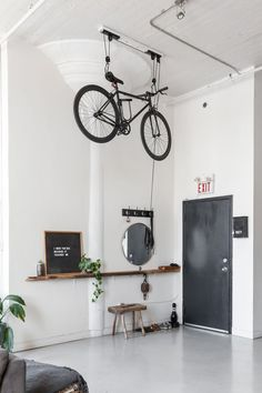Nautical Scandinavian Style in a Bright White Toronto Loft This Toronto apartment's super high ceilings work perfectly for this one-of-a-king bike pulley sy
