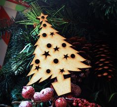 Laser cut Christmas tree comes in a pack of 5. Perfect for those Christmas craft ideas   By From amazon http://www.amazon.co.uk/gp/product/B00OK7WH6Y