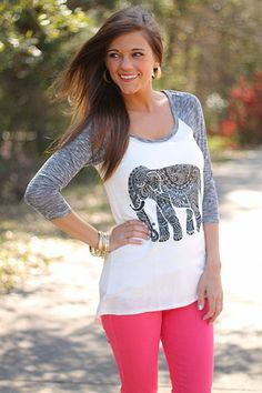 """EEEK this top is too stinkin cute!! We love the baseball style of it and of course the elephant. This one feels great and features a good bit of stretch:)   Fits true to size. Miranda is wearing the small.  from shoulder to hem:  small=30""""  medium=30.5  large=31"""