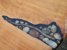 Wood table inlayed with seashells