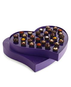 Wonder if Vosges truffles taste even more amazing when you eat them out of a heart box.