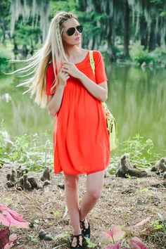 Young women in orange dress with black flats via barefootblonde.com