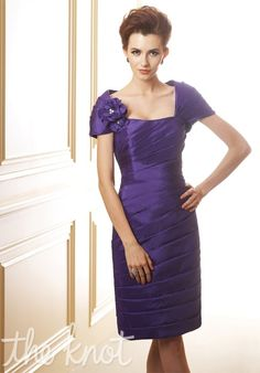 Dress features ruching, beaded pin, and matching shrug.