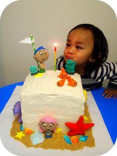 the birthday boy and his Bubble Guppies Cake
