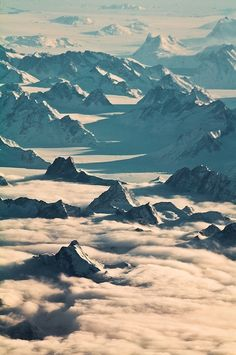 Aerial view of snow-covered mountains from plane over Greenland.