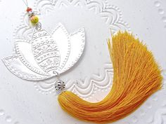 Hanging Flower Decoration, Silver Lotus Decor, Indian Patterns Embossed Metal, Boho Room Decor, Yellow Tassel by FoilingStar on Etsy https://www.etsy.com/listing/286025083/hanging-flower-decoration-silver-lotus