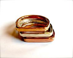 This set of 3 rings is hand forged and welded from Sterling Silver, 14 karat filled Rose Gold, and 14 karat filled Yellow Gold 12 gauge wire and are