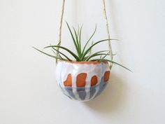 home and garden - Pale Blue and White Terracotta hanging ceramic pinch pot planter 2. $40.00, via Etsy.