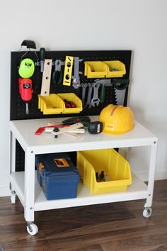 Ikea hack work bench: so adorable! Could also use the pegboard inside of a book case and switch it out with a pegboard with kitchen stuff.