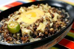 Sisig - a popular pulutan. Made from parts of pig's head and ear, seasoned with calamansi and chilli pepper