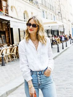 Since moving to Paris, Marissa Cox of Rue Rodier has learnt a few new French girl–inspired jean outfits that really work. See her top five combos here. White Shirt And Jeans, White Shirts, Blue Jeans, French Skincare, Moving To Paris, Straight Cut Jeans, Zara Shirt, Glamour, French Girls