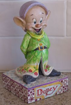 """Mom Birthday Gifts    If mom loves Snow White and the Seven Dwarfs, she will love this version of Dopey called """"Simply Adorable"""" by Jim Shore. This item has been SOLD but you can click on the picture to find more Snow White items in my eBay store."""