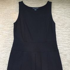 "BANANA REPUBLIC Gorgeous  Black Cocktail Dress 6P Banana Republic Gorgeous Sleeveless Black Cocktail dress. Medium weight stretch fabric 69% viscose 25% nylon 6% spandex. Has a curved neckline and two side pockets with a short zipper under the arm. Pleated around waistline, hugging fit that curves at the bottom for a very sexy look. Total length 39"" Just beautiful never been worn. BRAND NEW JUST LISTED ! Banana Republic Dresses Midi"