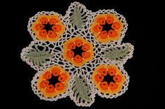 Art Threads: Gorgeous Poppy Doily, includes instructions for mesh between motifs, links to instructions for poppy and leaf motifs