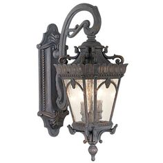 An ornate, elaborate outdoor lighting wall mount inspired by century Belgian designs and made by Kichler. high x wide. Extends from the wall. Style # 70807 at Lamps Plus. Outdoor Wall Mounted Lighting, Outdoor Light Fixtures, Outdoor Wall Lantern, Outdoor Wall Lighting, Outdoor Walls, Chandelier Lighting, Lamp Tattoo, Farmhouse Lighting, Antique Lighting