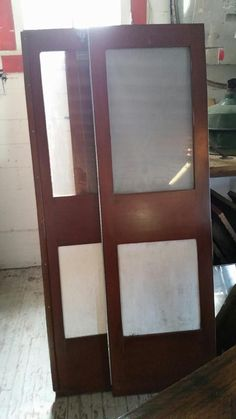 Cool Vintage 1950s mahogany sail boat doors. @tampabaysalvage Architectural Salvage and rare finds from across the globe.  Antique house parts, industrial, nautical, wrought iron, stained glass, hardware, vintage home decor.     www.tampabaysalvage.com