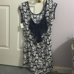 Super cute navy and white romper Super cute white and navy blue romper from Charlotte russe. Like new. Navy blue bow on back Charlotte Russe Other
