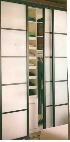Sliding closet doors. If mirrored this could be a DIY project. Use frosted contact paper and wood moulding to create divided sections. It'll look like rice paper panels.