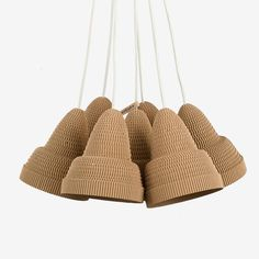 Cluster pendant with seven lamps made of cardboard. Also includes porcelain lamp sockets and white rubber cables.  Designer Alexandros Papadopoulos explores the possibilities of cardboard, trying to push the possibilities of this cheap and recyclable material to a whole new world where quality meets affordability. Each object is handmade, and therefore unique. Greek Design, Lamp Socket, First Choice, A Whole New World, Bucket Bag, Lamps, Objects, Cool Stuff, Unique