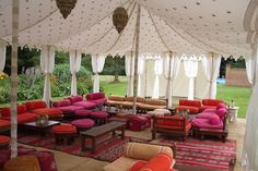 Some interesting tent set ups! I like this Bohemian element of adding some couches for different types of seating. It could take up some room and make it more cozy.