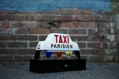 Pretty hot for this lamp made from a salvaged Paris taxi light. Not $1200 hot, but hot.