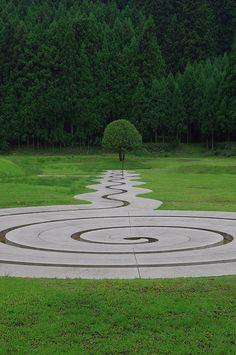 beautiful modern spiral design; 3 1/2 rotation; narrow line  ***  muro sanjo park - nara,  japan
